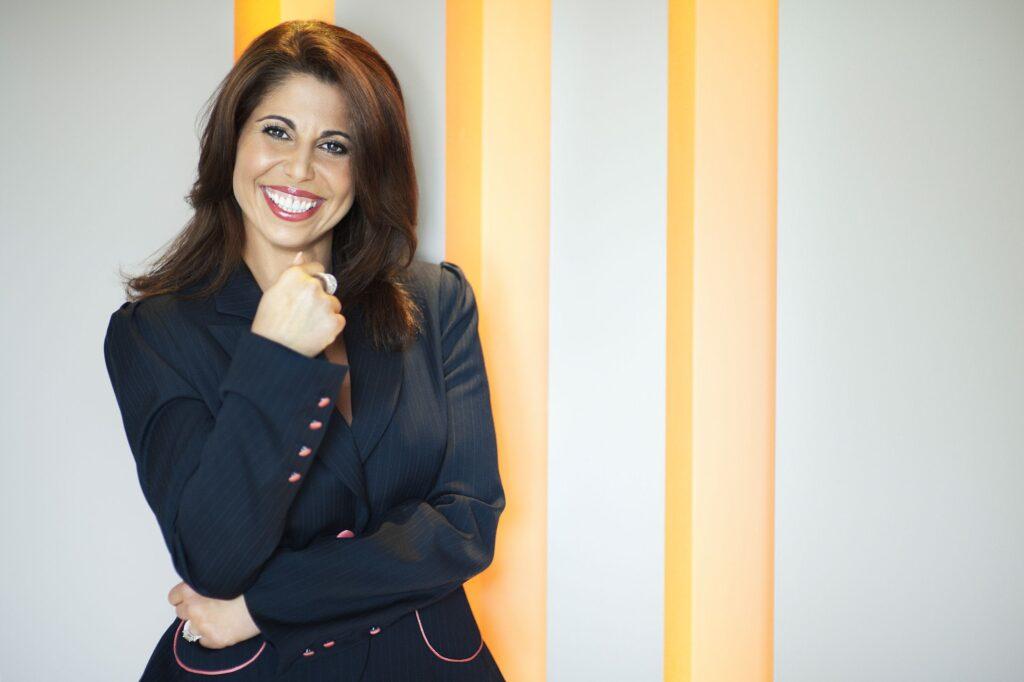 Tammy Hamawi on yellow stripe background
